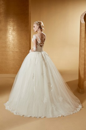 Elegant Long-Sleeve Ball Gown With Illusive Design And Lace Bodice