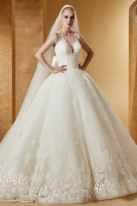 Feminine Cap Sleeve Ball Gown With Illusive Neckline And Back Bow