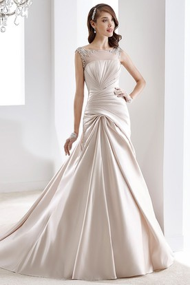 Cap Sleeve Beaded Satin Gown With Pleated Design And Illusive Neckline And Back