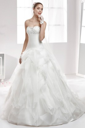 Strapless Wedding Gown With Ruffled Skirt and Beaded Bust