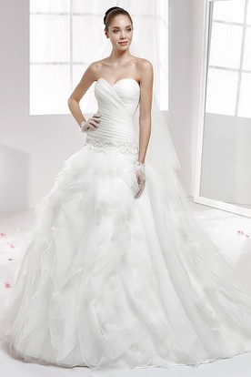 Sweetheart Beaded Wedding Gown With Cascading Ruffles and Pleated Bodice