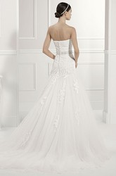 Strapless Tulle Bridal Gown With Crystal Waist And Removable Short Sleeves