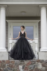A-Line Sleeveless Floor-length Straps Low-V Back Lace Ruffles Sash/Ribbon Black Wedding Dress