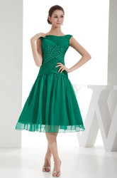 Knee-Length Bateau Ruched Criss-Cross Dress with Tulle Overlay and Beadings