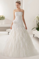 Strapless Tulle Mermaid Gown With Embroidered Waist And Tiered Skirt