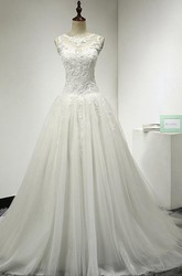 A-Line Tulle Bridal Gown With Lace Bodice and Dropped Waist