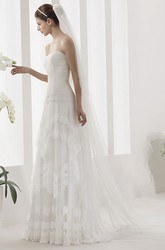 Strapless Tulle Gown With Ruched Bodice And Drop Jewel Waist
