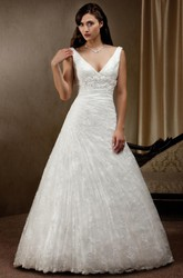 A-Line Floor-Length V-Neck Side-Draped Sleeveless Lace Wedding Dress With Appliques And Low-V Back