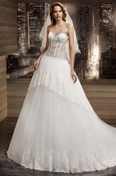 Sweetheart Illusion Beaded A-Line Bridal Gown With Peplum And Brush Train