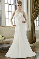 Sheath V-Neck Long Appliqued Sleeveless Chiffon Wedding Dress With Draping And Illusion Back