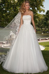 A-Line Sleeveless Long Appliqued Strapless Tulle Wedding Dress With Corset Back And Bow