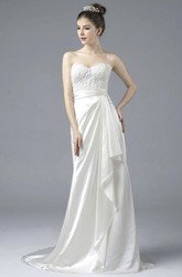 Elegant Satin Sweetheart Open Back Gown With Draping And Lace Appliques And Buttons