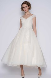 Elegant Organza Ball Gown Ankle Length Bridal Gown with Illusion Back and Flower