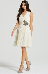 Short Criss-Cross Sleeveless V-Neck Tulle Bridesmaid Dress With Appliques