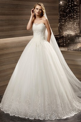 Strapless Liques A Line Bridal Gown With Pleated Waist And Lace Up Back