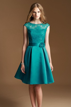 Cap Sleeved A Line Knee Length Dress With Lace Bodice And Flower