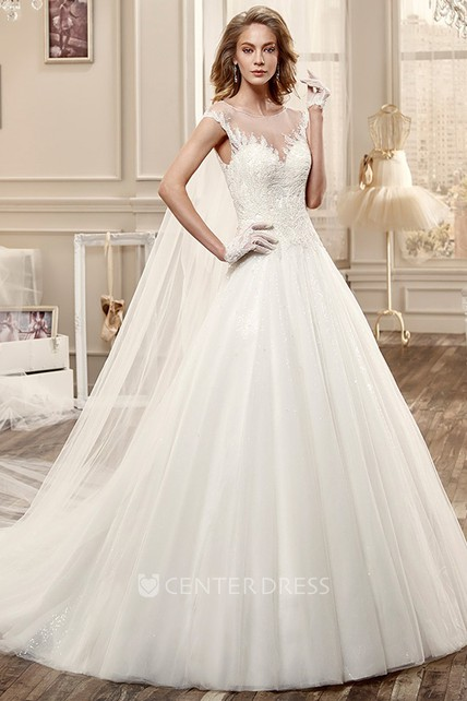 Luxurious Beaded Lace Cascades Over A Shimmering Metallic Underlay In This Majestic Ball Gown Wedding Dress The Open Back Is Accented By Delicate